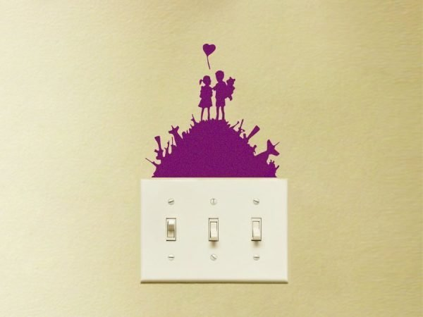 Banksy light switch decal of kids on gun hill