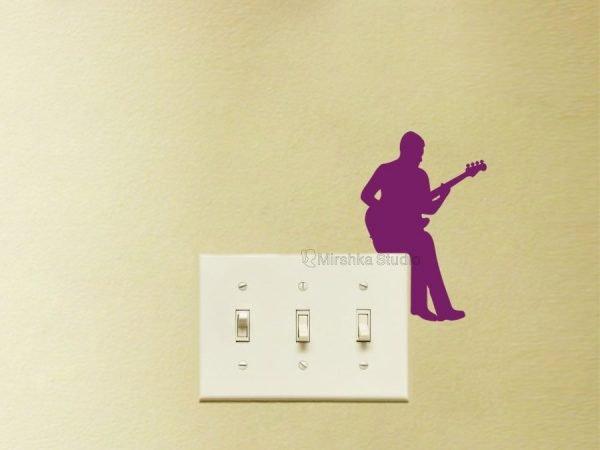 bass player light switch decor
