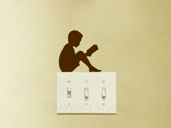 boy reading sticker