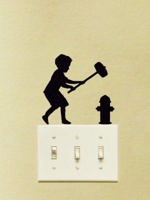 dorm room wall decor of Banksy hammer boy
