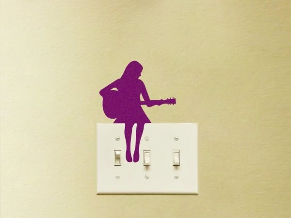 girl play guitar light switch decor