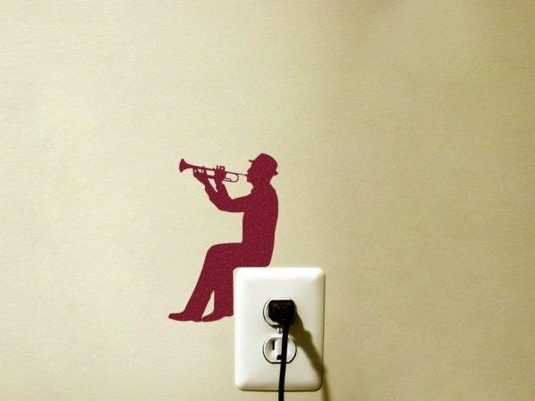 trumpet player light switch decor