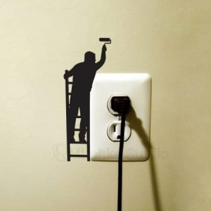 Man Painting A Wall Sticker