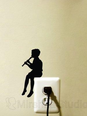 little boy play the flute
