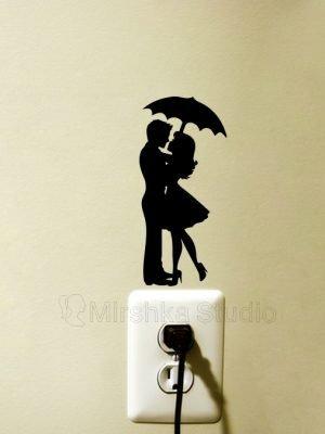 kissing couple under umbrella sticker