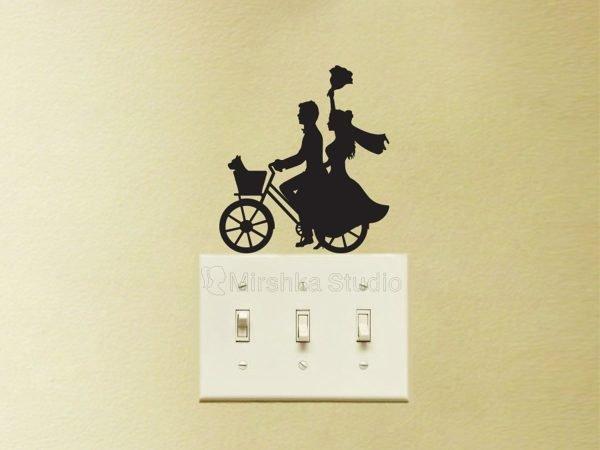 married couple on a bike sticker